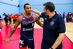 Gentrey Thomas and Bristol Flyers coach Andreas Kapoulas after Bristol Flyers win 92-72 - Rogan/JMP - 11/10/2019 - BASKETBALL - SGS Wise Arena - Bristol, England - Bristol Flyers v Plymouth Raiders - BBL Cup.