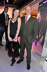 CAMILLA RUTHERFORD and DOMINIC BURNS at a reception to celebrate the launch of 'A Crystal Christmas'  - inspired by Swarovski and held at Harrods, Knightsbridge, London on 8th November 2011.  Following the reception a private dinner was held at One Hyde Park, Knightsbridge.