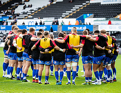 Dragons players huddle during the pre match warm up<br /> <br /> Photographer Simon King/Replay Images<br /> <br /> Guinness PRO14 Round 18 - Ospreys v Dragons - Saturday 23rd March 2019 - Liberty Stadium - Swansea<br /> <br /> World Copyright © Replay Images . All rights reserved. info@replayimages.co.uk - http://replayimages.co.uk