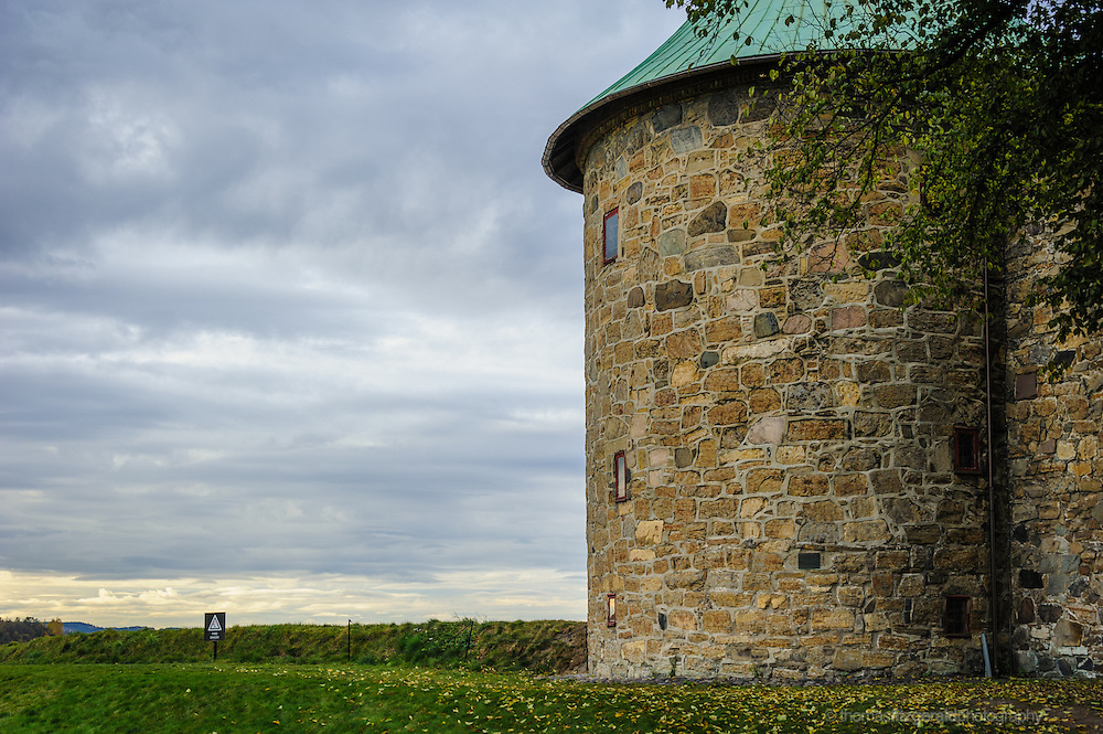 Oslo, Norway, October 2012: Round Section of Oslo Fortress with moody sky behind
