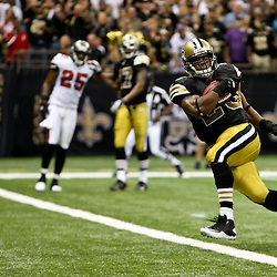 November 6, 2011; New Orleans, LA, USA; New Orleans Saints running back Pierre Thomas (23) runs for a touchdown against the Tampa Bay Buccaneers during the third quarter of a game at the Mercedes-Benz Superdome. Mandatory Credit: Derick E. Hingle-US PRESSWIRE
