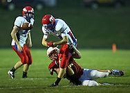 Decorah's Cole Svestka (6) fumbles the ball as he is hit by Marion's Ethan Herren (2) during the game between the Decorah Vikings and the Marion Indians at Thomas Park in Marion on Friday, August 31, 2012.