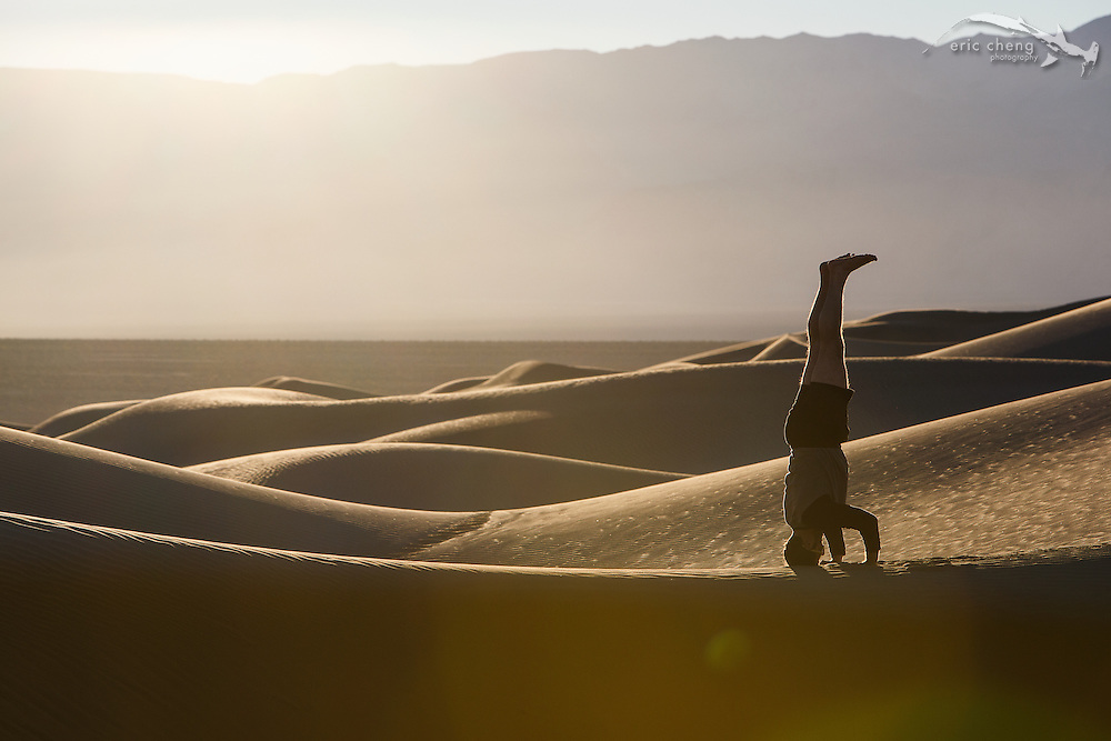 Dan Kitchens does a headstand at Mesquite Dunes in Death Valley