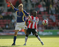 Photo: Lee Earle.<br /> Southampton v Cardiff City. Coca Cola Championship. 21/10/2007. Cardiff's Glenn Loovens (L) battles with Stern John.