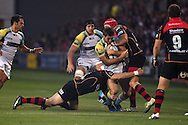 Andrew Bishop of the Ospreys &copy; is tackled by Tyler Morgan of the Dragons. Guinness Pro12 rugby union, Newport Gwent Dragons v Ospreys at Rodney Parade in Newport, South Wales on Friday 12th Sept 2014<br /> pic by Andrew Orchard, Andrew Orchard sports photography.