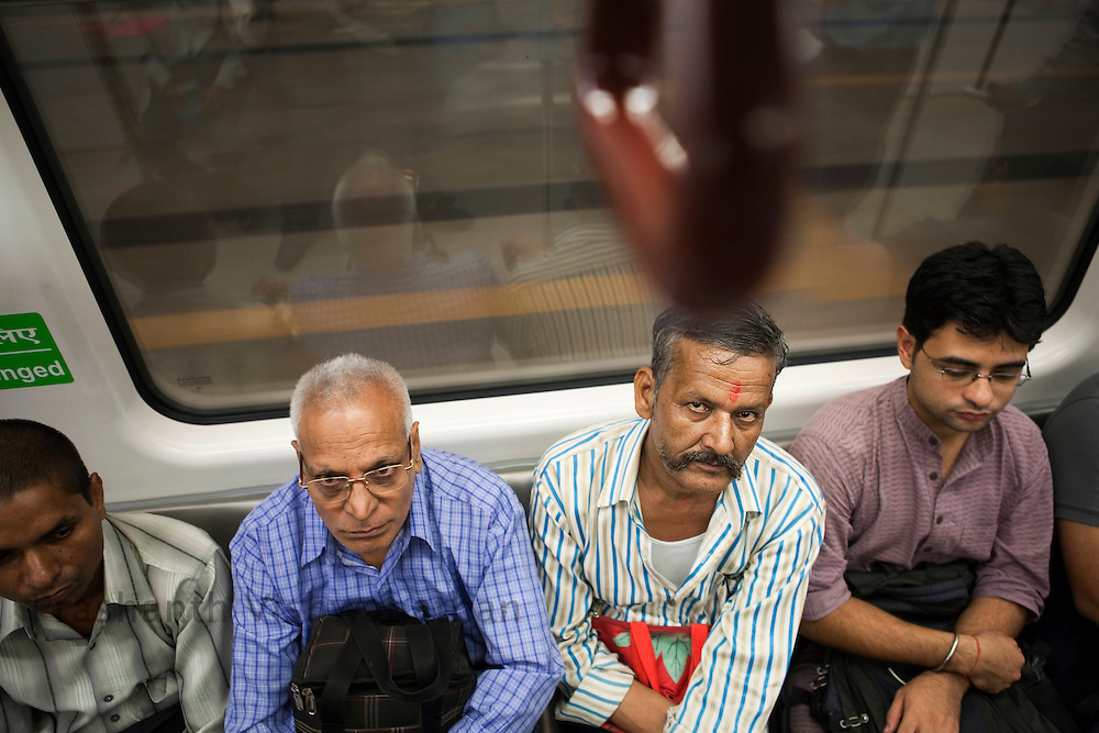 "Shiv Dudd (moustache) 55, travels inside a metro train from the Central Secratariat station using the ""Yellow Line"" route of the Delhi Metro network in New Delhi, India, on Friday, October 22, 2010. Photographer: Prashanth Vishwanathan/HELSINGIN SANOMAT"