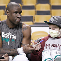 10 May 2012: Boston Celtics small forward Mickael Pietrus (28) is seen with a young fan after giving him his sneakers prior to the Boston Celtics 83-80 victory over the Atlanta Hawks, in Game 6 of the Eastern Conference first-round playoff series, at the TD Banknorth Garden, Boston, Massachusetts, USA.
