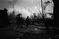 Fire fighters battle a structure fire in the Mid Town area of New Orleans 7, October 2005 Fire fighters are battling blazes in the dry conditions 5 weeks after hurricane katrina made land fall over 5 weeks ago.    photo by darren hauck