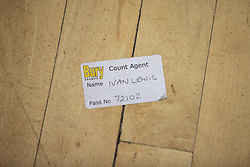 © Licensed to London News Pictures . 13/12/2019. Bury, UK. Name sticker for former Bury South MP Ivan Lewis discarded on the floor at the count for seats in the constituencies of Bury North and Bury South in the 2019 UK General Election , at Castle Leisure Centre in Bury . Photo credit: Joel Goodman/LNP