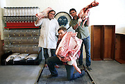Butchers Tom Mylan (L) Ben Turley (R) and Brent Yong (C) pose for a portrait on a giant scale at the Brooklyn Kitchen labs in New York.