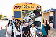 Students pose for a photo with (from left to right) Eva Ballada, Milpitas Wal-Mart personell manager, Kristian Lecours, Principal, Brian Shreve, MUSD MOT Supervisor, and Losa Foster, Wal-Mart assistant manager, during a Fill-A-Bus event with school supplies donated by Wal-Mart at Randall Elementary School in Milpitas, California, on September 5, 2013. (Stan Olszewski/SOSKIphoto)