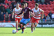 Scunthorpe United forward Lee Novak (17) and Doncaster Rovers midfielder Ben Whiteman (12)  during the EFL Sky Bet League 1 match between Doncaster Rovers and Scunthorpe United at the Keepmoat Stadium, Doncaster, England on 17 September 2017. Photo by Ian Lyall.