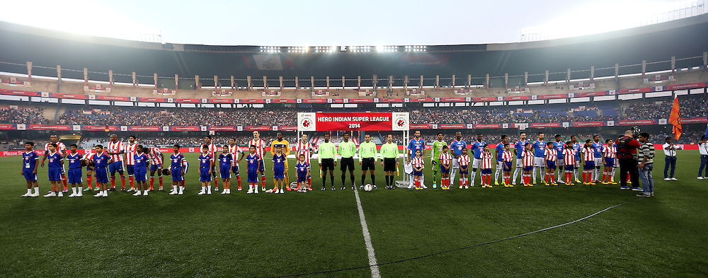 Atl?tico de Kolkata players and FC Goa players stand for the national anthem during match 55 of the Hero Indian Super League between Atl&eacute;tico de Kolkata and FC Goa held at the Salt Lake Stadium in Kolkata, West Bengal, India on the 10th December 2014.<br /> <br /> Photo by:  Sandeep Shetty/ ISL/ SPORTZPICS