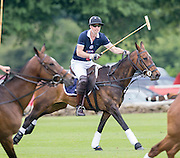 TETBURY - UK - 18th June 2016: Prince William, HRH The Duke of Cambridge plays a charity polo match at the Beaufort Festival of Polo near Tetbury in Gloucestershire.<br /> <br /> Prince William was watched by his brother Prince Harry and Zara Phillips with her daughter Mia.<br /> Photograph by Ian Jones
