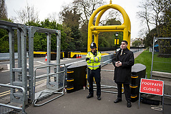 © London News Pictures. 22/04/2016. London, UK. Aolice officer and a member of the secret service stand next to security barriers. Heightened security surrounding the residence of the US Ambassador to the United Kingdom in Regents Park, London, where the President of the United States Barak Obama is staying during his visit to the UK. Photo credit: Ben Cawthra/LNP