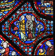 Noah's wife and 3 daughters, from the Life of Noah stained glass window, 13th century, in the nave of Chartres cathedral, Eure-et-Loir, France. Chartres cathedral was built 1194-1250 and is a fine example of Gothic architecture. Most of its windows date from 1205-40 although a few earlier 12th century examples are also intact. It was declared a UNESCO World Heritage Site in 1979. Picture by Manuel Cohen