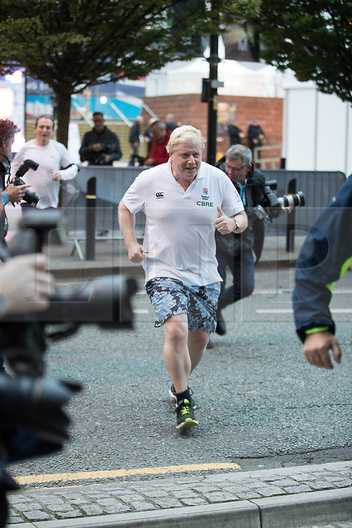 © Licensed to London News Pictures . 02/10/2017. Manchester, UK. Foreign Secretary BORIS JOHNSON goes jogging . The second day of the Conservative Party Conference at the Manchester Central Convention Centre . Photo credit: Joel Goodman/LNP
