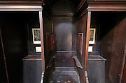 close up of an open confessional Italy