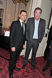 Left to right, MARTIN SANDER Director of Audi UK and JEREMY CLARKSON at the Audi Ballet Evening held at the Royal Opera House, Bow Street, Covent Garden, London on 22nd March 2012.