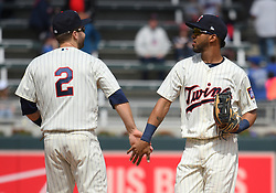 May 2, 2018 - Minneapolis, MN, U.S. - MINNEAPOLIS, MN - MAY 02: Minnesota Twins Second base Brian Dozier (2) and Minnesota Twins Left field Eddie Rosario (20) celebrate a win after a MLB game between the Minnesota Twins and Toronto Blue Jays on May 2, 2018 at Target Field in Minneapolis, MN.The Twins defeated the Blue Jays 4-0.(Photo by Nick Wosika/Icon Sportswire) (Credit Image: © Nick Wosika/Icon SMI via ZUMA Press)