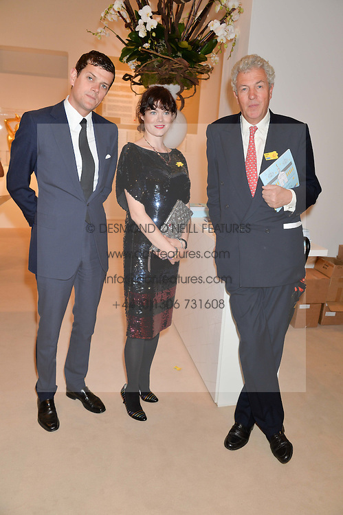 Left to right, the HON.ALEXANDER SPENCER-CHURCHILL, JASMINE GUINNESS and HENRY WYNDHAM at the Masterpiece Marie Curie Party supported by Jeager-LeCoultre held at the South Grounds of The Royal Hospital Chelsea, London on 30th June 2014.