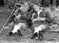 Twelfth, Belfast, N Ireland, 12th July 1969 - Two members of York Road Girls Band have a snooze after the walk from the other side of Belfast to The Field at Finaghy, South Belfast, N Ireland. 196907120189g<br />