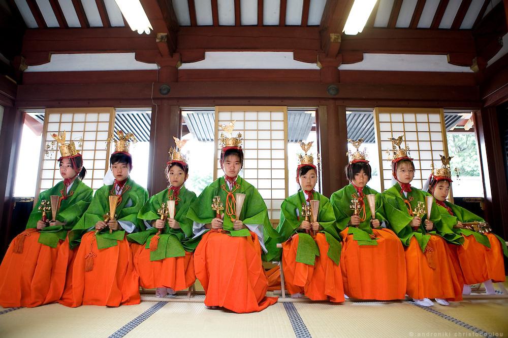 Young girls that performe a relegious dance, siting in the inner yard of Hongu (the main shrine) on the 2nd day of the 3-day anual ritual of Tsurugaoka Hachimangu Shrine in Kamakura