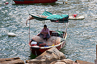 Tanka Fisherwoman mending nets, Aberdeen Fishing Village, Hong Kong, Hong Kong