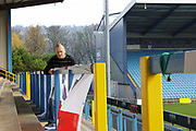 Halifax Town supporter putting up flags before the Vanarama National League match between FC Halifax Town and Dover Athletic at the Shay, Halifax, United Kingdom on 17 November 2018.