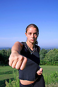 fist - attractive young woman practicing self defense