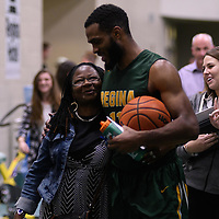 4th year forward Brian Ofori (11) of the Regina Cougars with fans after the home game on November  5 at Centre for Kinesiology, Health and Sport. Credit: /Arthur Images