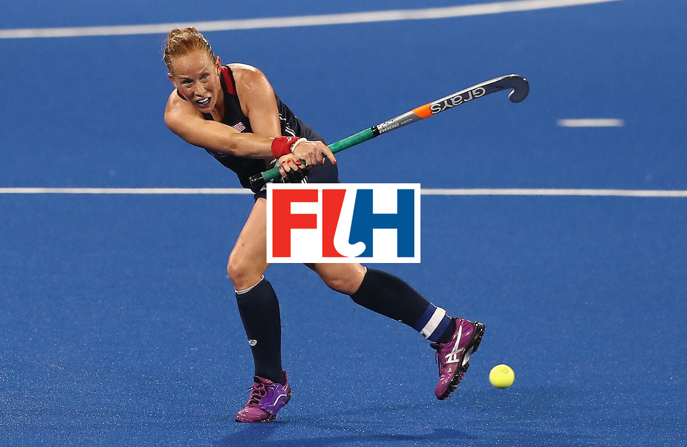 RIO DE JANEIRO, BRAZIL - AUGUST 13:  Lauren Crandall of the USA passes the ball during the Women's group B hockey match between Great Britain and the USA on Day 8 of the Rio 2016 Olympic Games at the Olympic Hockey Centre on August 13, 2016 in Rio de Janeiro, Brazil.  (Photo by David Rogers/Getty Images)