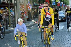 Bradley Wiggins with his son Ben cycle down the Champs Elysees in Paris after  winning  the Tour de France, Sunday, 22nd July 2012.  Photo by:  i-Images / Bureau233