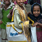 Young girls outside Biruh Tesfa, in Addis Ababa. Biruh Tesfa means bright future in Amharic, and is a program for urban adolescent girls at risk of exploitation and abuse. For many girls, going to Biruh Tesfa is their only hope of an education and a respite from their domestic work. ..The program promotes functional literacy, life skills, livelihoods skills, and HIV/reporductive health education through girls' clubs led by adult female mentors. The girls' clubs are held in meeting spaces donated by the kebele (local administration).