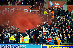 26.12.2012, Britannia Stadion, Stoke on Trent, ENG, Premier League, Stoke City vs FC Liverpool, 19. Runde, im Bild Liverpool supporters set off a red smoke bomb as they celebrate Luis Alberto Suarez Diaz winning a penalty against Stoke City during the English Premier League 19th round match between Stoke City FC and FC Liverpool at the Britannia Stadium, Stoke on Trent, Great Britain on 2012/12/26. EXPA Pictures © 2012, PhotoCredit: EXPA/ Propagandaphoto/ David Rawcliffe..***** ATTENTION - OUT OF ENG, GBR, UK *****