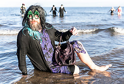 The traditional Loony Dook took place at Portobello just outside Edinburgh. Revellers dressed in costumes take a dip into the Firth of Forth to welcome in the New Year.