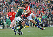 Jaque Fourie of the Springboks is tackled high by Mike Phillips of the Lions.<br /> Rugby - 090704 - Springboks vs British&Irish Lions - Coca-Cola Park - Johannesburg - South Africa. The Lions won 28-9 but lost the series 2-1 to the Springboks.<br /> Photographer : Anton de Villiers / SASPA