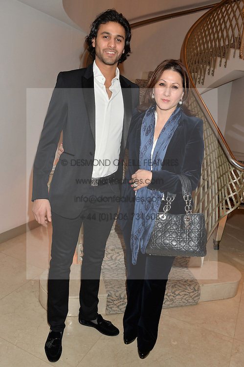 RITA SHARMA is the founder of the travel agency Worldwide Journeys and her son ROHAN SHARMA at the Fortune Forum Club dinner in the presence of HSH Prince Albert II of Monaco held at The Dorchester, Park Lane, London on 15th January 2014.