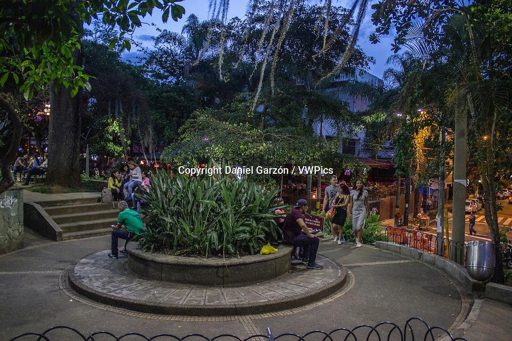 People sitting enjoying the park Lleras