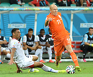 Arjen Robben (right) of Netherlands and Junior Diaz of Costa Rica during the 2014 FIFA World Cup match at the Itaipava Arena Fonte Nova, Nazare, Bahia<br /> Picture by Stefano Gnech/Focus Images Ltd +39 333 1641678<br /> 05/07/2014