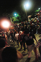 """MEXICO, Veracruz, Tantoyuca, Oct 27- Nov 4, 2009. Night """"cuadrillo"""" practice went on until well past midnight in this Tantoyuca neighborhood. """"Xantolo,"""" the Nahuatl word for """"Santos,"""" or holy, marks a week-long period during which the whole Huasteca region of northern Veracruz state prepares for """"Dia de los Muertos,"""" the Day of the Dead. For children on the nights of October 31st and adults on November 1st, there is costumed dancing in the streets, and a carnival atmosphere, while Mexican families also honor the yearly return of the souls of their relatives at home and in the graveyards, with flower-bedecked altars and the foods their loved ones preferred in life. Photographs for HOY by Jay Dunn."""