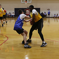 Matthew Bell of DeSoto tries to get the ball away from Grover Fairly of Hattiesburg Saturday during the Special Olympics MIssissippi Spring Games basketball tournament