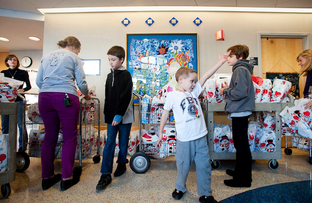 Nathan Norman, his family and their friends deliver Nathan's Christmas Bags to The Preston Robert Tisch Brian Tumor Center at Duke Hospital.  In one year, the program went from delivering 300 bags to 3,000 to other kids fighting cancer.  Each bags contains toys and a Bible.