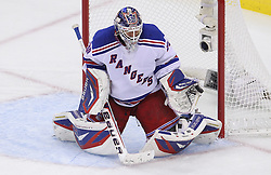 May 21, 2012; Newark, NJ, USA; New York Rangers goalie Henrik Lundqvist (30) makes a glove save during the second period in game four of the 2012 Eastern Conference Finals at the Prudential Center.