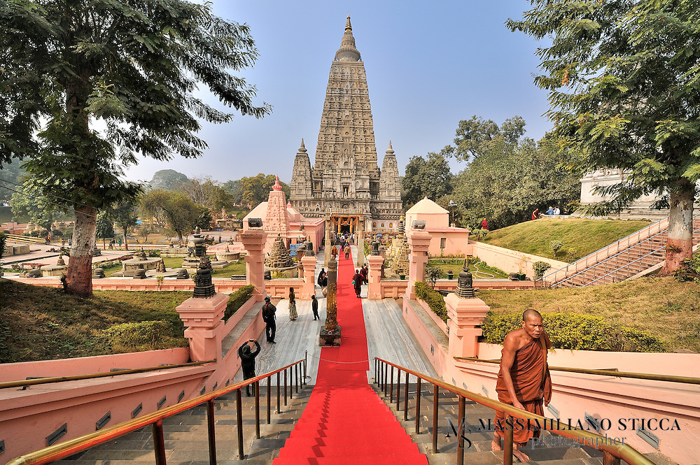 The historical place at which the Enlightenment took place became a place of pilgrimage. Though it is not mentioned in the scriptures, the Buddha must have visited Bodh Gaya again in the course of his teaching career. About 250 years after the Enlightenment, the Buddhist Emperor, Ashoka visited the site and is considered the founder of the Mahabodhi Temple. According to the tradition, Ashoka, as well as establishing a monastery, erected a diamond throne shrine at this spot with a canopy supported by four pillars over a stone representation of the Vajrasana, the Seat of Enlightenment.<br /> The temple's architecture is superb but its history is shrouded in obscurity. It was constructed with the main intention of making it a monument and not a receptacle for the relics of the Buddha. Several shrines were constructed with enshrined images for use as places of worship.<br /> The basement of the present temple is 15m square, 15m in length as well as in breadth and its height is 52m which rises in the form of a slender pyramid tapering off from a square platform. On its four corners four towers gracefully rise to some height. The whole architectural plan gives pose and balance to the observers.<br /> Inside the temple there is a colossal image of the Buddha in the &quot;touching the ground pose&quot;, bhumisparsha mudra. This image is said to be 1700 years old and is facing east exactly at the place where the Buddha in meditation with his back to the Bodhi tree was enlightened.
