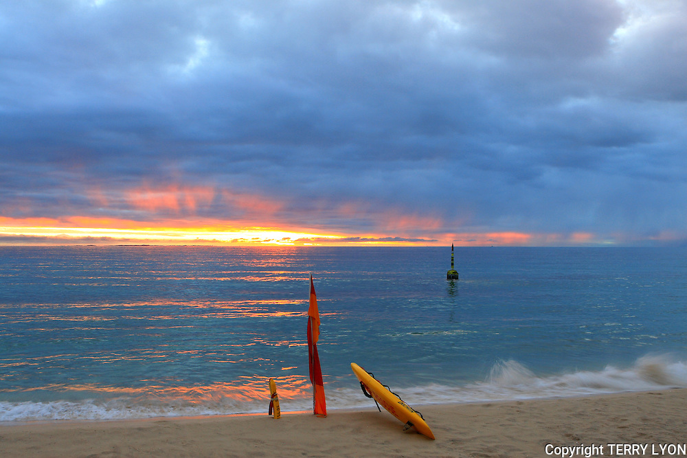 A Cottesloe Beach lifesavers equipment rescue ready on the beach at sunset.