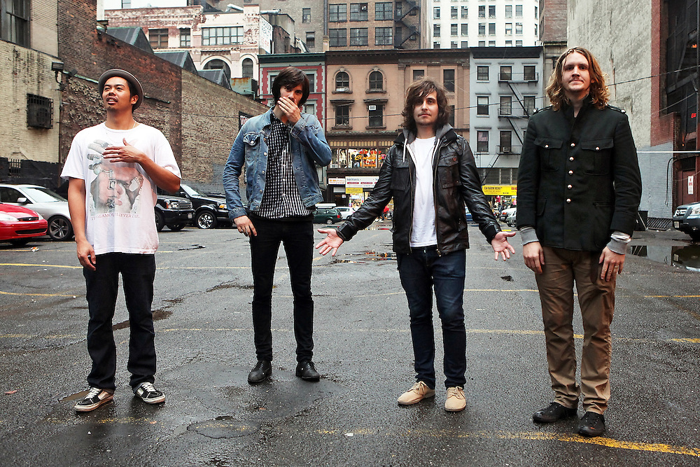 "NEW YORK - OCTOBER 24:  (L to R) Dougy Mandagi, Toby Dundas, Lorenzo Sillitto and Jonathon Aherne of The Temper Trap pose for a portrait after their performance at Levi's and The Fader's ""One Day Only"" at Liberty Hall at Ace Hotel on October 24, 2009 in New York City.  (Photo by Roger Kisby/Getty Images)"