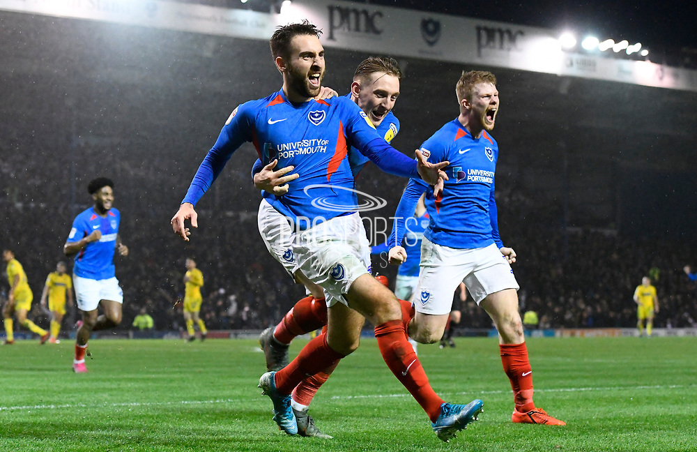 Goal - Ben Close (33) of Portsmouth celebrates after he scores a goal to give a 1-0 lead with Ronan Curtis (11) of Portsmouth during the EFL Sky Bet League 1 match between Portsmouth and Wycombe Wanderers at Fratton Park, Portsmouth, England on 26 December 2019.