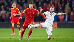 CARDIFF, WALES - Tuesday, November 19, 2019: Wales' Aaron Ramsey battles with Hungary's Gergő Lovrencsics during the final UEFA Euro 2020 Qualifying Group E match between Wales and Hungary at the Cardiff City Stadium. (Pic by Laura Malkin/Propaganda)