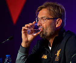 HONG KONG, CHINA - Tuesday, July 18, 2017: Liverpool's manager Jürgen Klopp takes a sip from a glass of water during a press conference at the Grand Hyatt Hotel Hong Kong ahead of the Premier League Asia Trophy 2017. (Pic by David Rawcliffe/Propaganda)